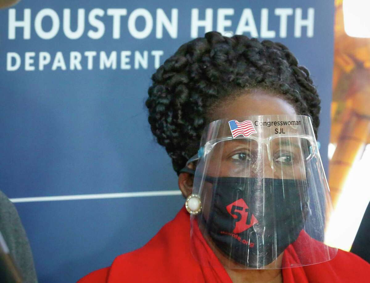 Congresswoman Shelia Jackson Lee wears a protective mask before she addressed the press at the COVID-19 vaccine mega site in Minute Maid Park Saturday, Jan. 9, 2021, in Houston.