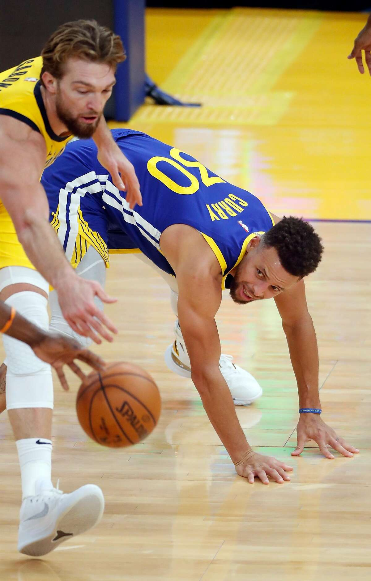 Golden State Warriors' Stephen Curry turns the ball over to Indiana Pacers' Donatas Sabonis in 3rd quarter during NBA game at Chase Center in San Francisco, Calif., on Tuesday, January 12, 2021.