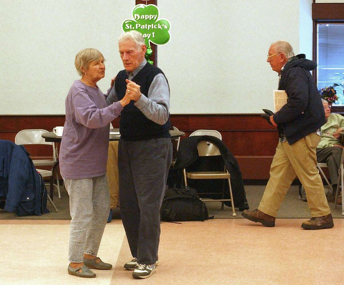 Stratford, Connecticut-HVIZDAK-3/9/05: Francis Lucas, 76, left, dances wih Peter Gurrieri, 87, both of Stratford, to the sound of traditional Irish music sang by Pierce Campbell during a St. Patrick's Day celebration at the Stratford Baldwin Senior Center. Photograph by Peter Hvizdak ph0294a #024
