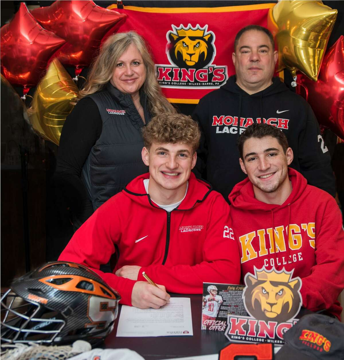 Evan Azary, surrounded my mom Jennifer, dad Joe and brother Alex, celebrates his choice to play soccer at King's College.