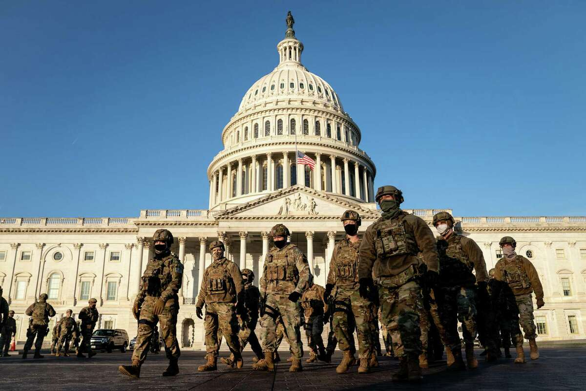 National Guard troops outside the Capitol in Washington on Wednesday, Jan. 13, 2021. A week after the violent siege at the U.S. Capitol and a week ahead of President-elect Joe Biden's inauguration, officials are bracing for uncertainty and preparing for the potential of violence in the days ahead. (Erin Schaff/The New York Times)