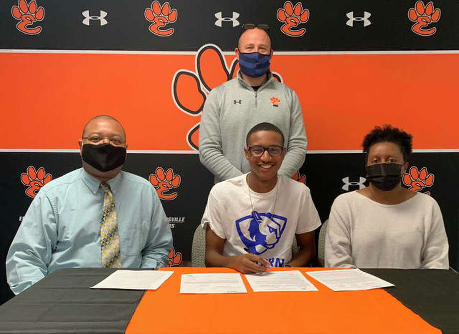 Edwardsville High School senior Brandon Battle, seated center, will run men's track and field at Eastern Illinois University. He is joined by his parents and EHS track and field coach Chad Lakatos. Photo: Matt Kamp|The Intelligencer