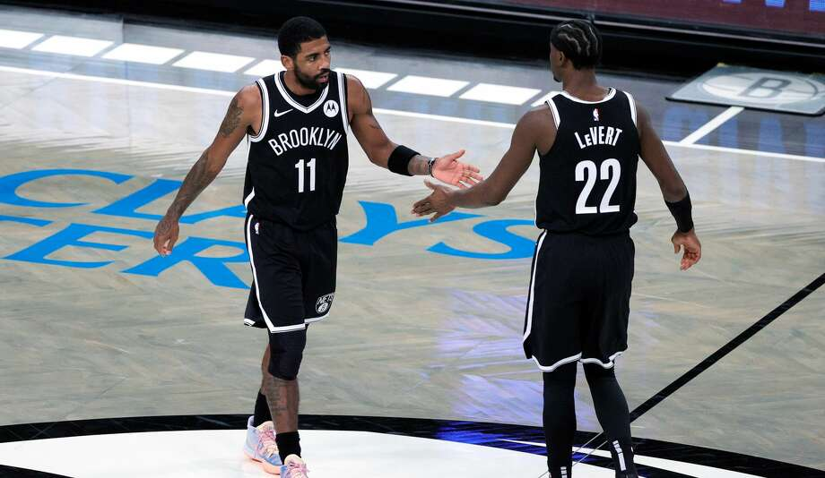 The Nets are willing to part with anyone besides Kevin Durant - including Kyrie Irving (left) and Caris LeVert (right) - in a potential trade for James Harden. Photo: Sarah Stier/Getty Images / 2020 Getty Images