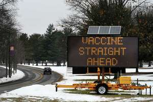 A sign on the University at Albany Campus directs traffic to the site of a new vaccine distribution center being built at the Northwest Gold parking lot on Wednesday, Jan. 13, 2021, in Albany, N.Y. (Will Waldron/Times Union)