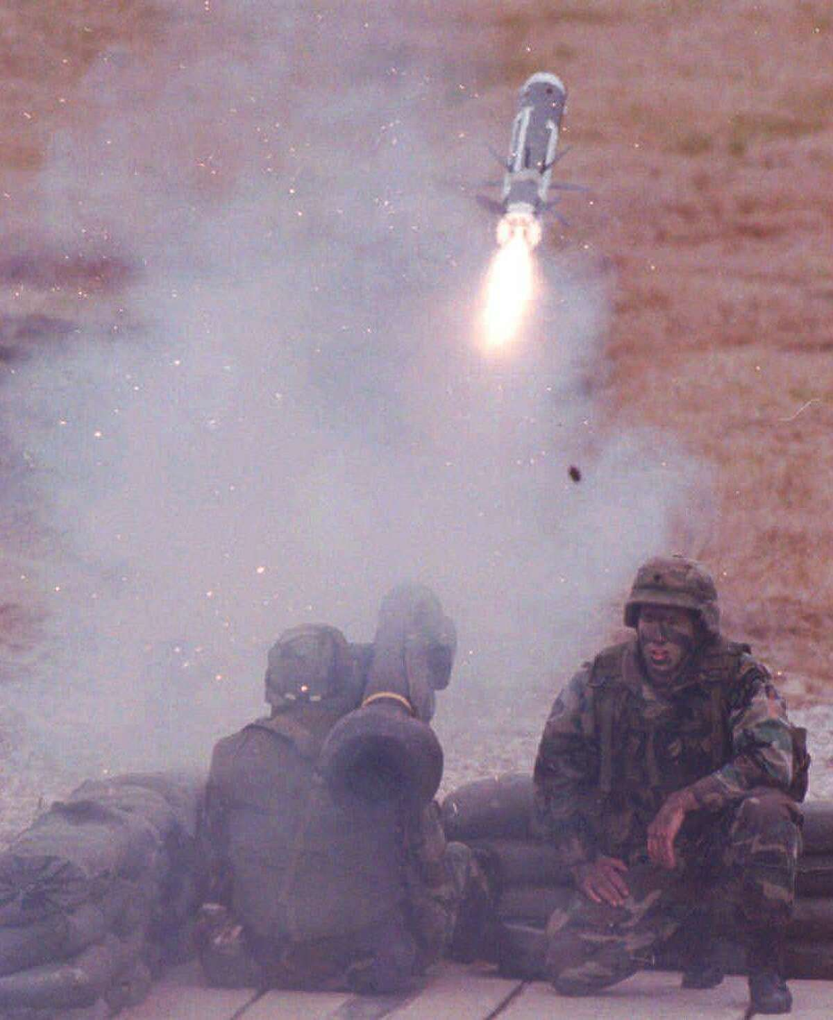 Staff Sgt. Gary Thompson at Redstone Arsenal in Huntsville, Ala., fires a Javelin missile at a Soviet T72 battle tank located 2,400 meters downrange during a training exercise in the 1990s. (AP Photo/Huntsville Times, Dave Dieter)