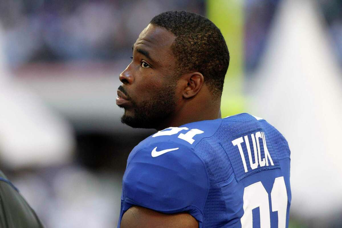 New York Giants' Justin Tuck (91) stands on the sideline during an NFL football game against the Dallas Cowboys Sunday, Oct. 28, 2012, in Arlington, Texas.