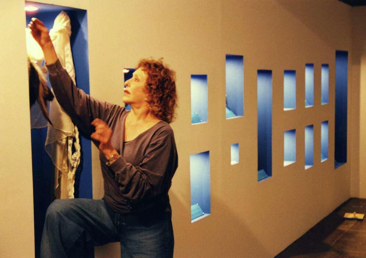 """Carolee Schneemann works on her 1999 Artpace installation """"Vesper's Pool."""""""