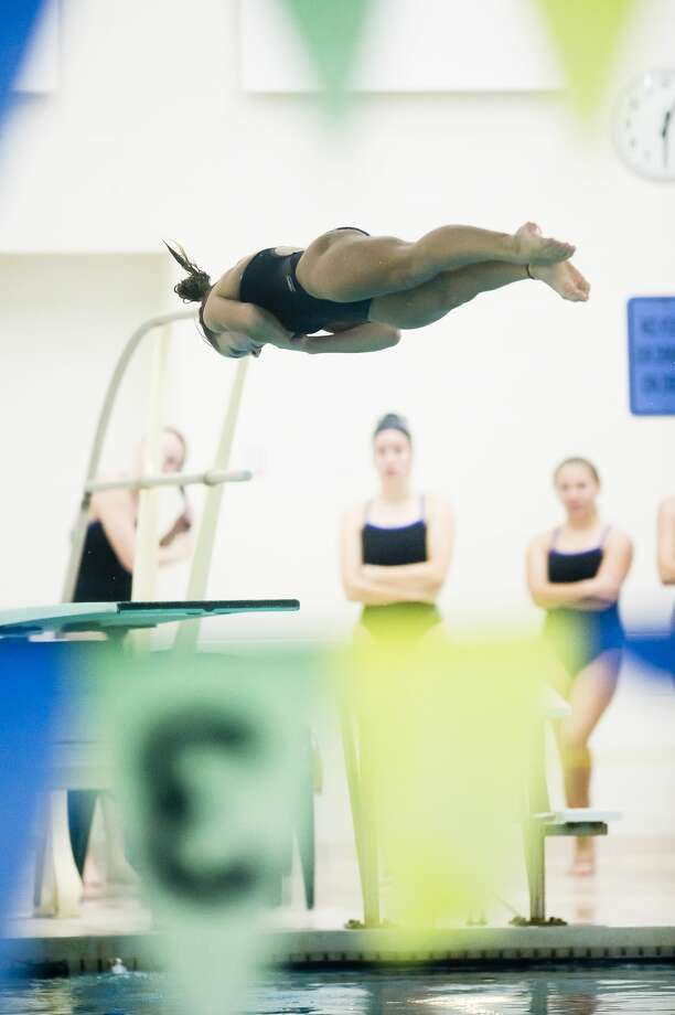 Dow High's Emily Krzciok competes in 1-meter diving during a Nov. 2, 2020 meet against Midland High. Photo: Daily News File Photo