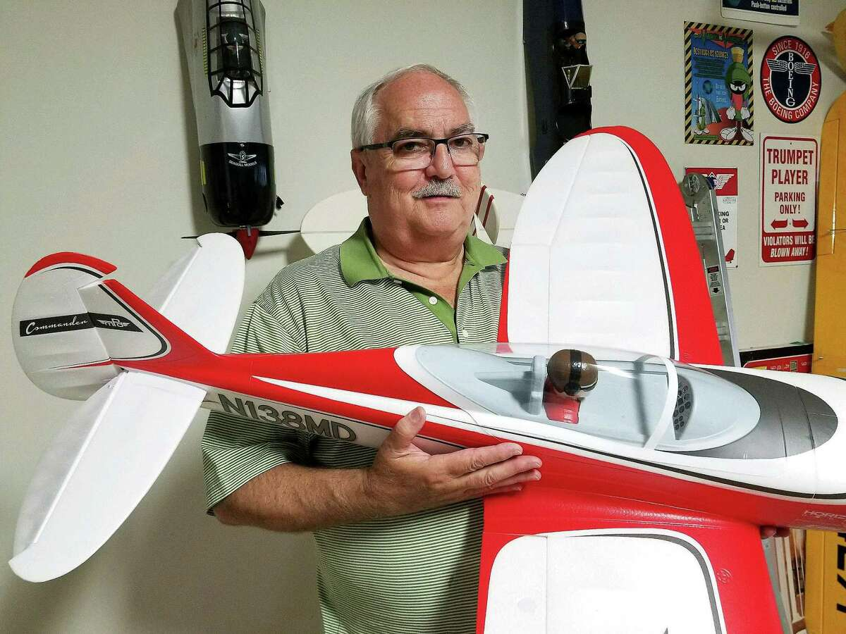 Randy Shewmaker, treasurer for the SPARKS RC Club, holds an E-flite Commander electric-powered sport plane that is available as a plug and play ARF (almost ready to fly). It requires little assembly and costs approximately $200. With a $50 battery, good transmitter/receiver (under $300), the intermediate level plane would be ready to fly. There are similar beginner ARF's for under $400.
