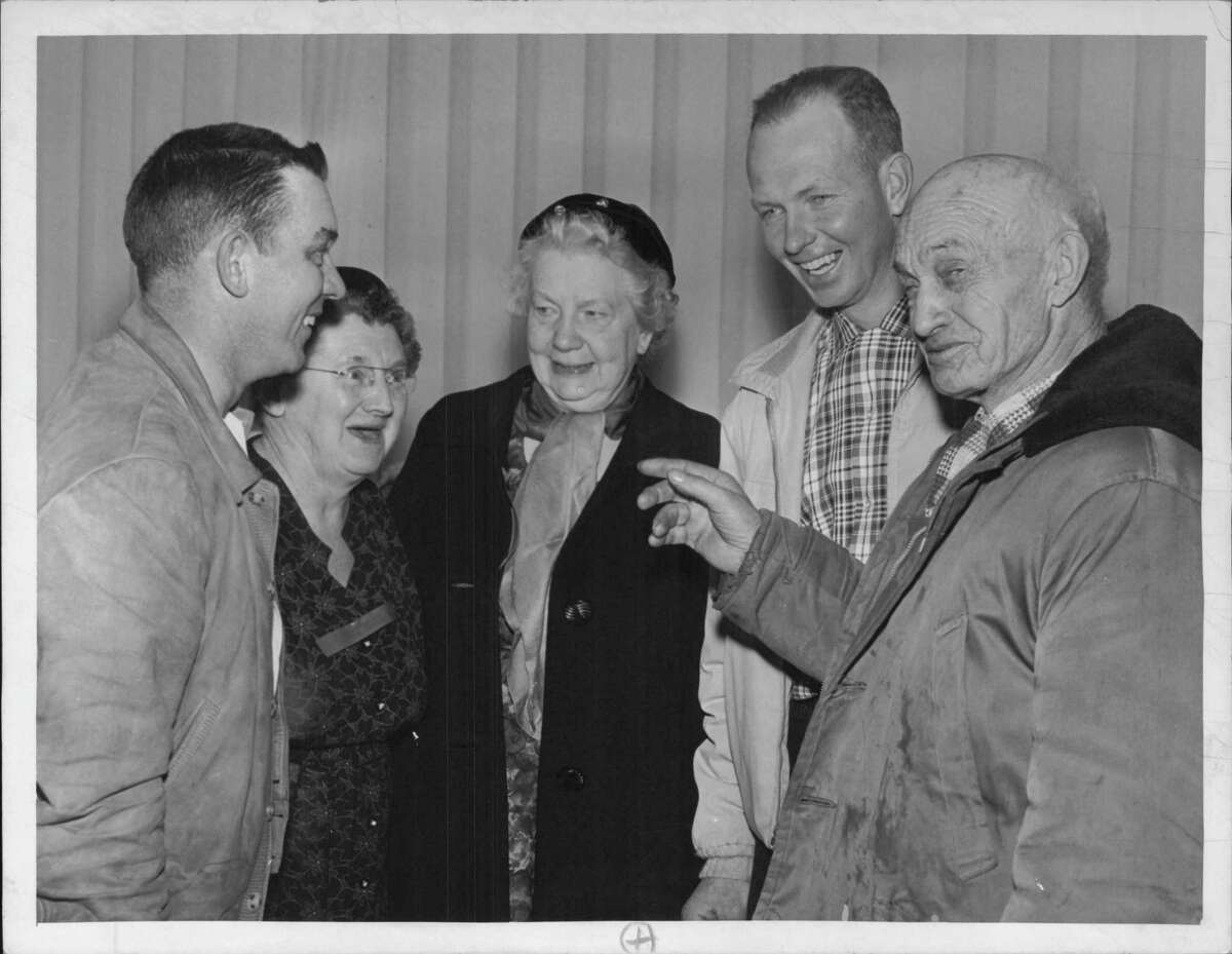 In January 1964, former teachers and pupils of the 85-year old Coeymans Hollow School get together to chat of bygone days at the one-room school. Listening to Willis Stott of Coeymans Hollow, right, tell of his days as a pupil are Harold Collins, left, and Robert L. VanEtten, both graduates of the old school district, and Anna M. Fisher, left, and Helene VanEtten, who both were teachers at the Coeymans Hollow School. (Times Union Archive)