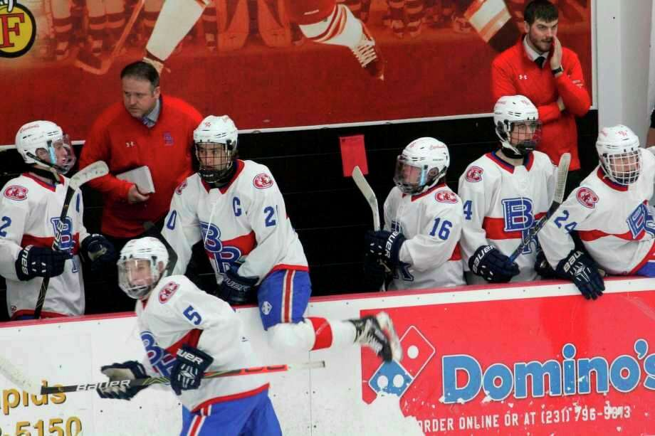 Big Rapids hockey coach instructs his players while they change lines during a game last season. (Pioneer file photo)