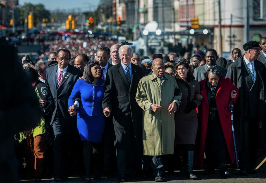 Vice President Joe Biden walks, alongside civil rights leaders and lawmakers, over the historic Edmund Pettus Bridge in Selma, Ala., on March 3, 2013. Photo: Washington Post Photo By Melina Mara / The Washington Post