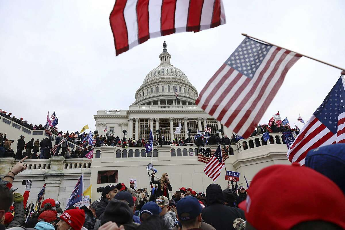 FILE - In this Wednesday, Jan. 6, 2021 file photo, supporters of President Donald Trump gather outside the U.S. Capitol in Washington. (AP Photo/Shafkat Anowar)