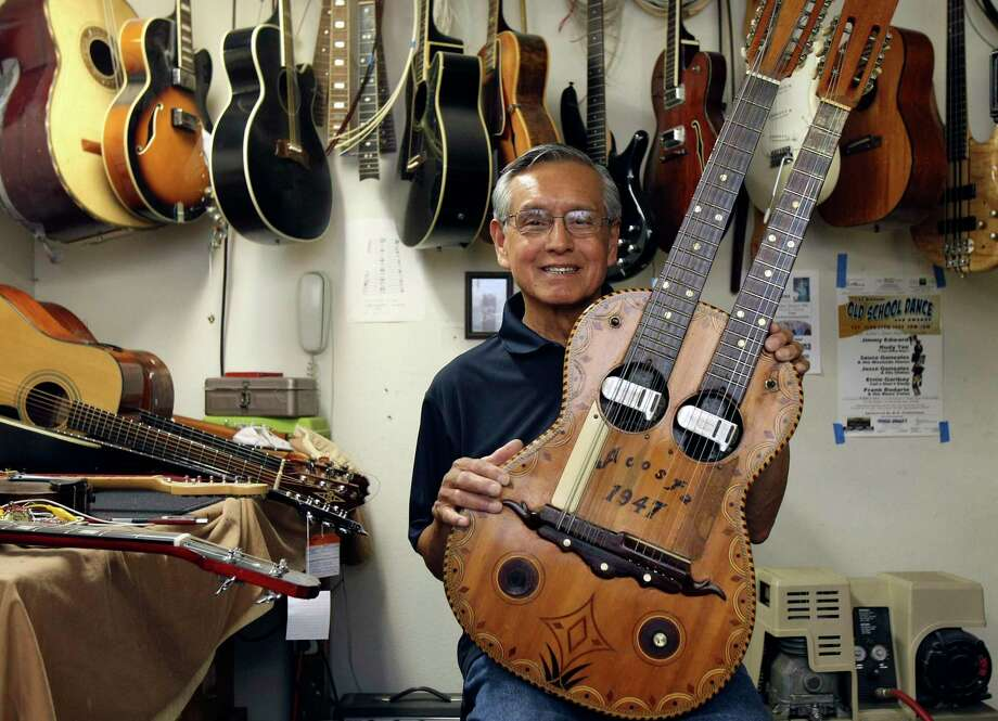 Mike Acosta, pictured at Acosta Music Co. in 2011, shows off a double-neck bajo sexto and guitar built by his father, Miguel. Mike Acosta, who ran the renowned family business until his retirement a few years ago, died Jan. 5 at age 81. Photo: Staff File Photo / SAN ANTONIO EXPRESS-NEWS