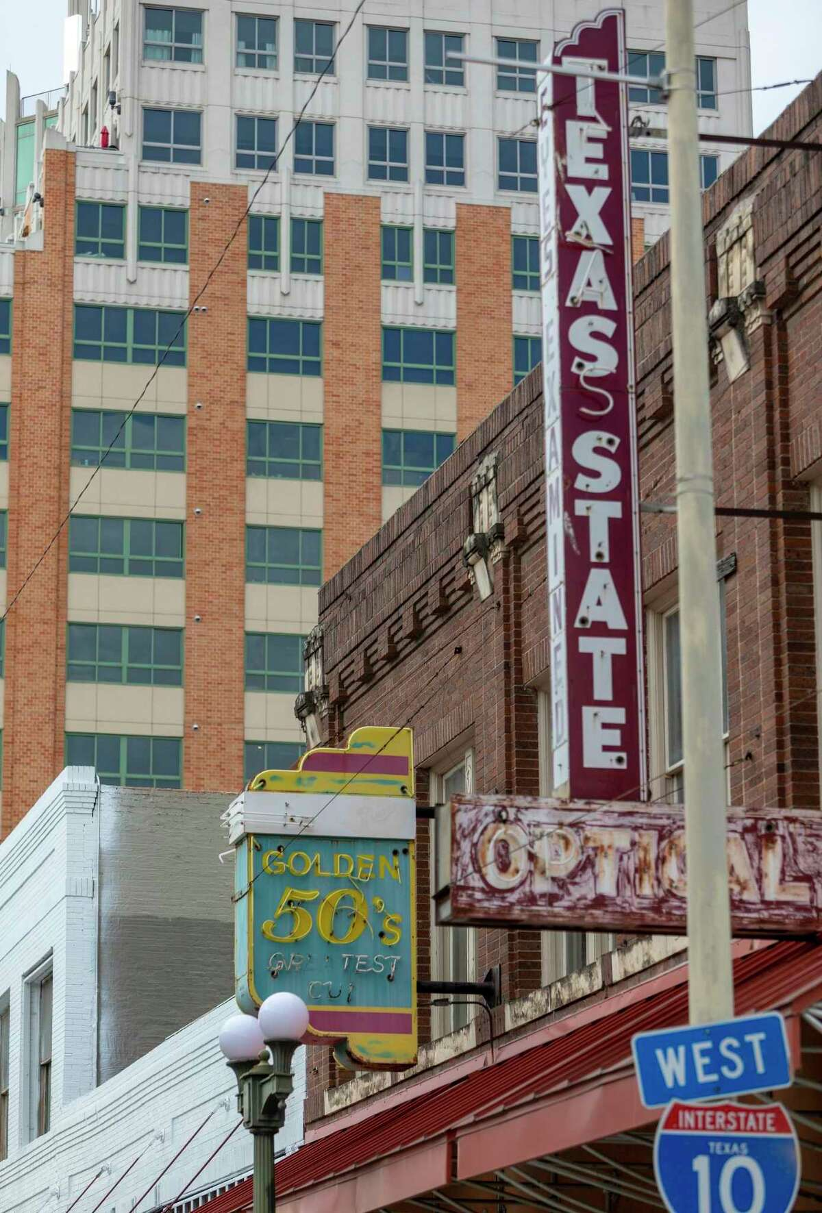 Neon signs are seen Jan. 12, 2021 on buildings on the 300 block of Commerce Street in downtown San Antonio.