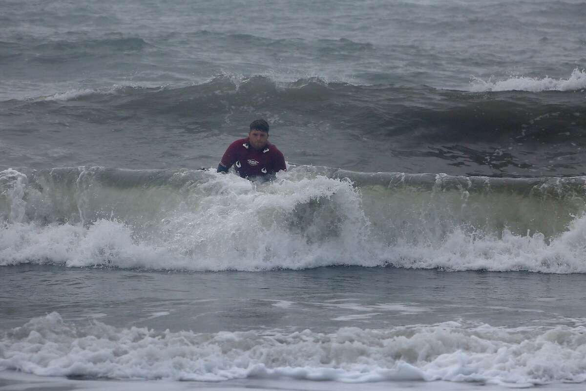 """Alo"" Slebier of Santa Cruz rides in on a wave toward Mavericks Beach."