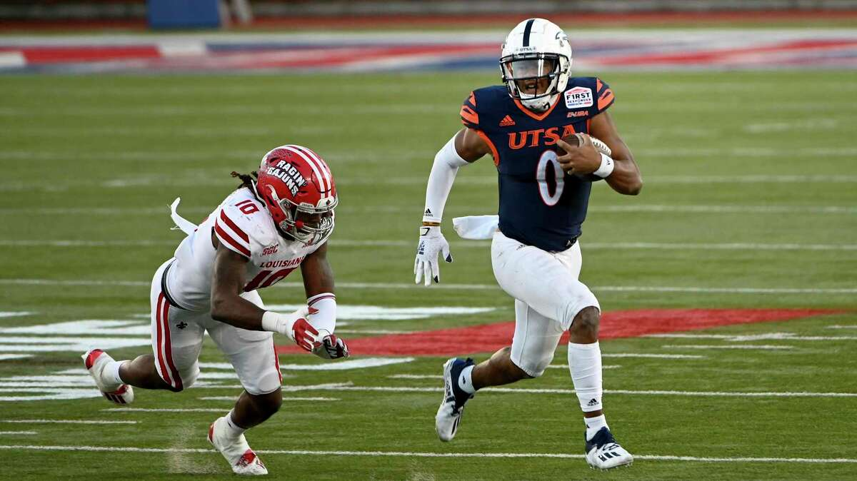 UTSA quarterback Frank Harris (0) runs upfield past Louisiana-Lafayette linebacker Andre Jones (10) in the third quarter during the First Responder Bowl NCAA college football game in Dallas, Saturday, Dec. 26, 2020. (AP Photo/Matt Strasen)