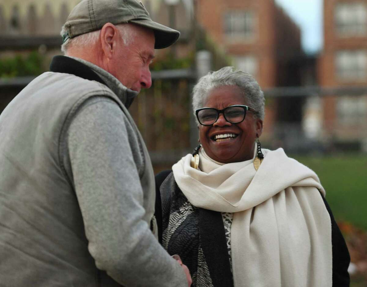 Candidate for Bridgeport mayor Marilyn Moore chats with a supporter outside the polls at the Bassick High School in Bridgeport, Conn. on Tuesday, November 5, 2019.