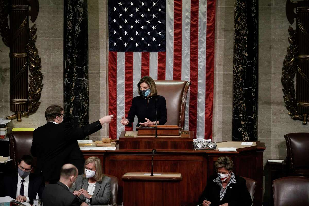 Speaker of the House Nancy Pelosi, D-Calif., leads the final vote of the impeachment of President Donald Trump, for his role in inciting an angry mob to storm the Congress last week, at the Capitol in Washington, Wednesday, Jan. 13, 2021.