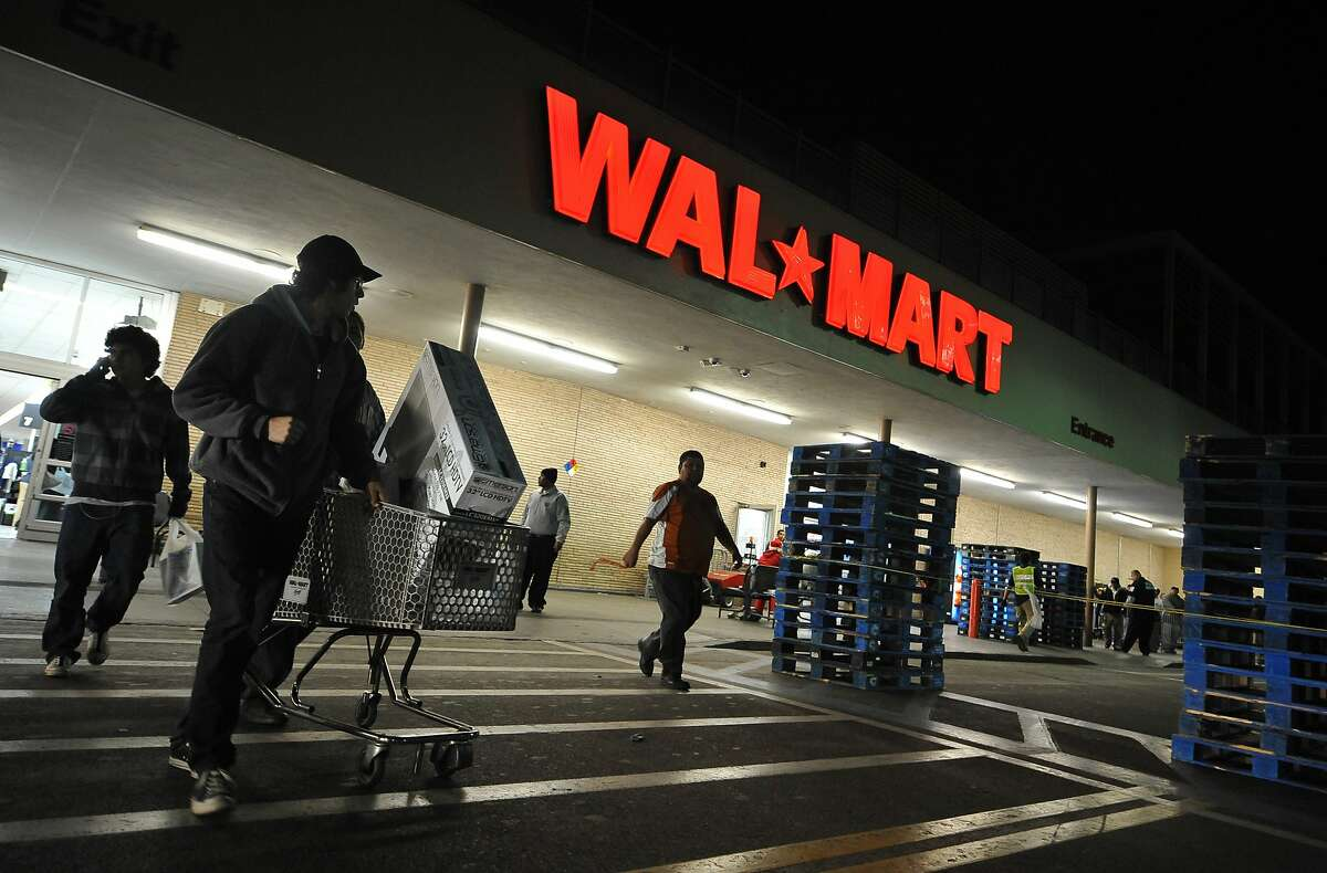 Shoppers wheel their purchases out of a Wal-Mart store in Los Angeles, California, before dawn on Black Friday, November 27, 2009. A major settlement with the company in 2010 over improper storage and handling of toxic waste helped the California District Attorney's Association secure $210,000 to support future public-interest environmental litigation.