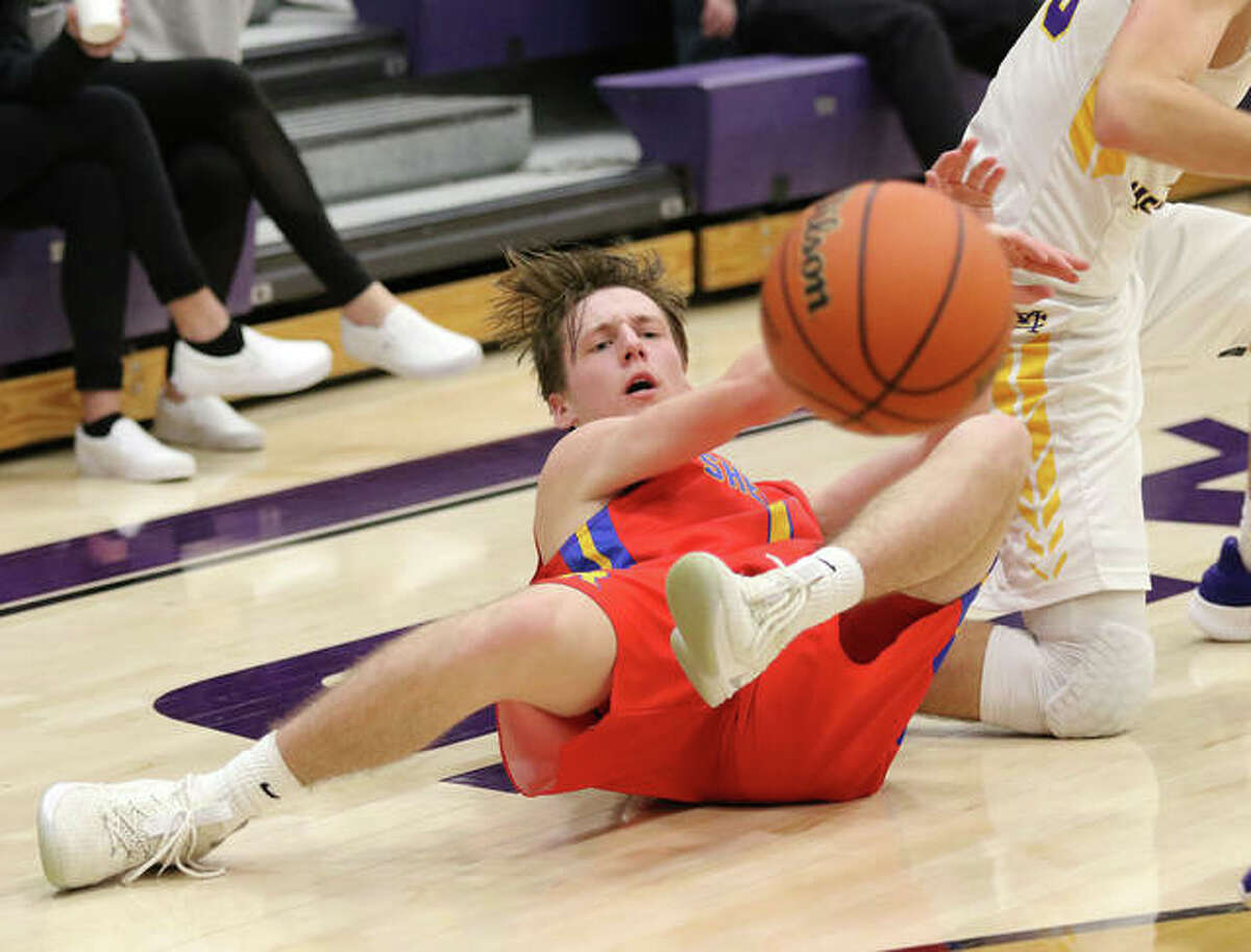 Roxana's Andrew Beckman delivers a pass to a teammate after coming up with a loose ball in a 2019 Class 3A regional game at Breese Central. Beckman, and the state's other seniors, remain on pause with Wednesday's announcement from the IHSA.