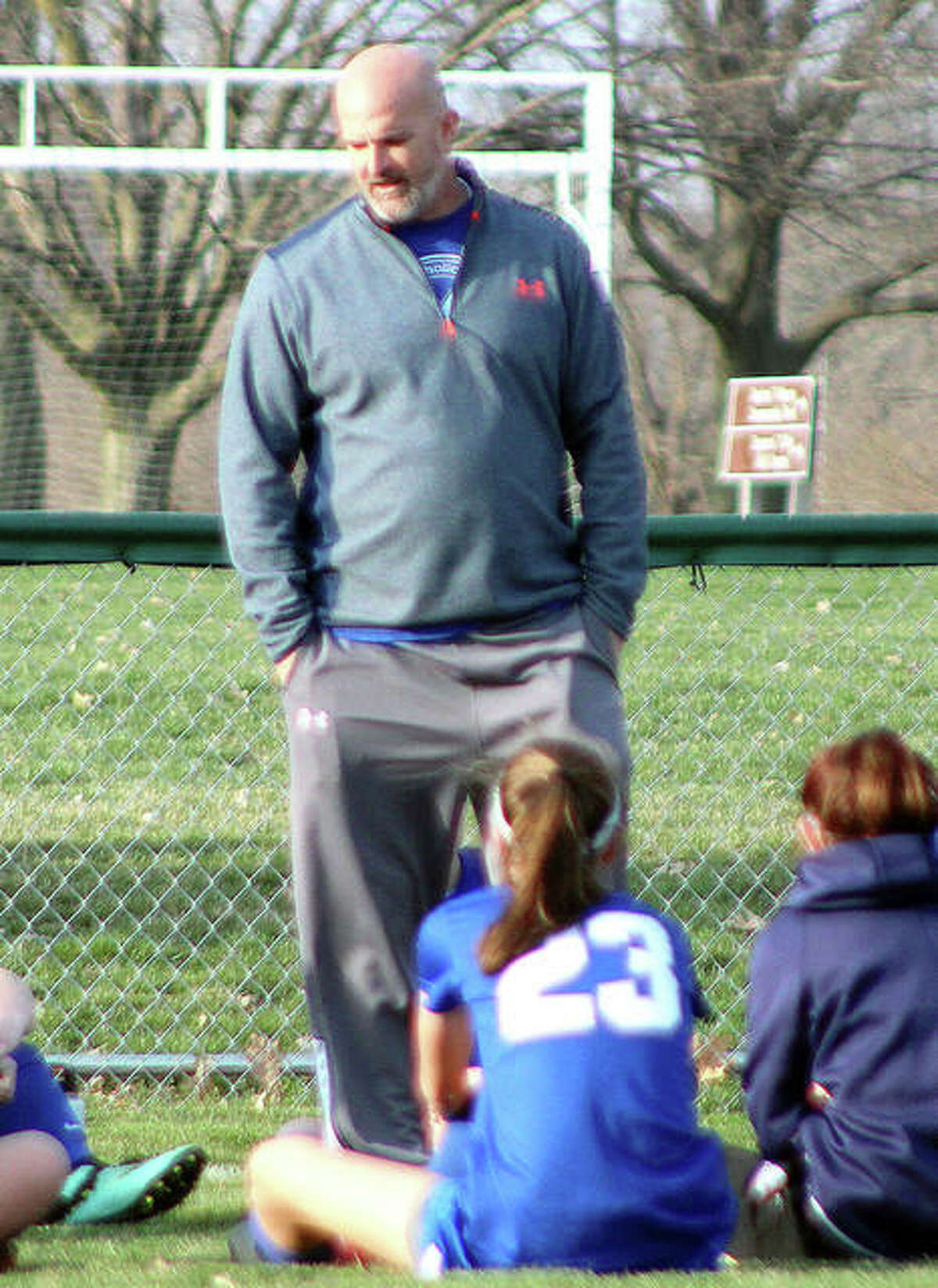 Brian Hoener, the Marquette athletic director and girls soccer coach, speaks with his soccer team in 2019. Hoener said that families, students and coaches are growing more frustrated with the lack of guidance as it pertains to winter sports after the announcement that IHSA sports remain paused.