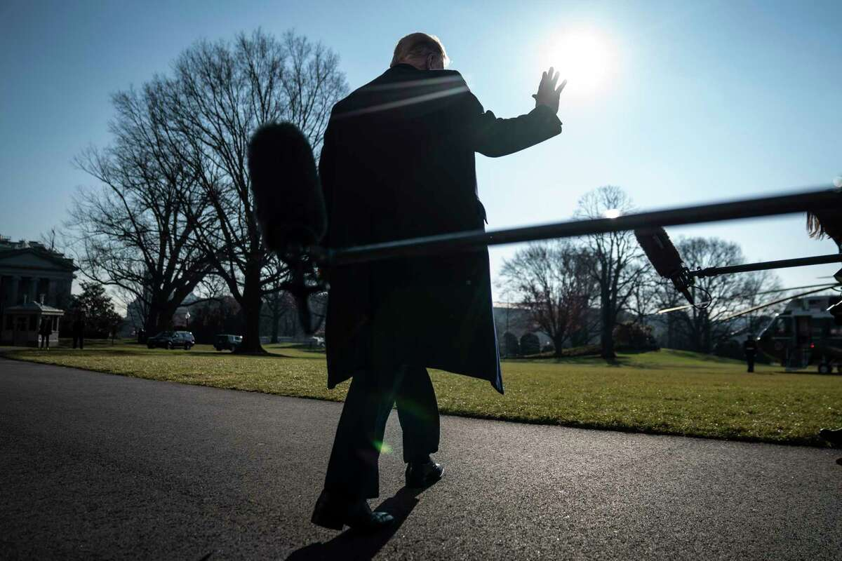 President Trump stops to talk to reporters as he walks to board Marine One and depart from the South Lawn on Tuesday.