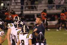 West Hardin Oilers head football coach George Taylor giving instructions to his team during its loss against Warren on Friday, Sept. 11, 2020 in Warren, TX.