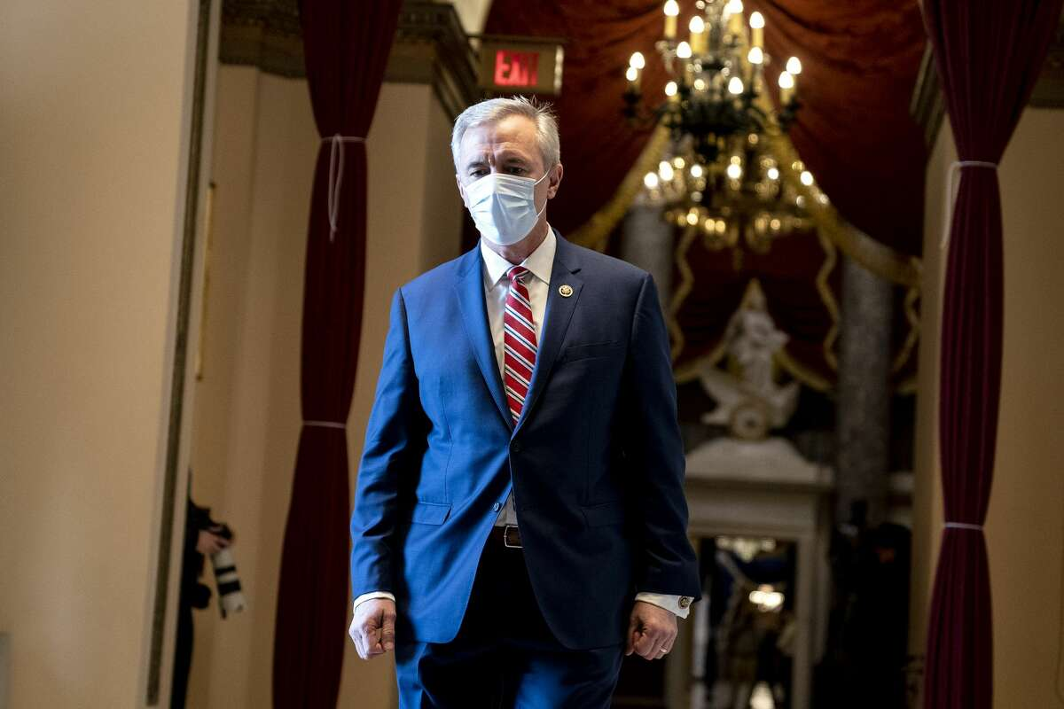 WASHINGTON, DC - JANUARY 13: Rep. John Katko (R-NY) wears a protective mask while walking to the House Floor at the U.S. Capitol on January 13, 2021 in Washington, DC. The House of Representatives moved forward with impeachment following Vice President Mike Pences refusal to use the 25th amendment to remove Trump from office after protestors breached the U.S. Capitol last week. (Photo by Stefani Reynolds/Getty Images)