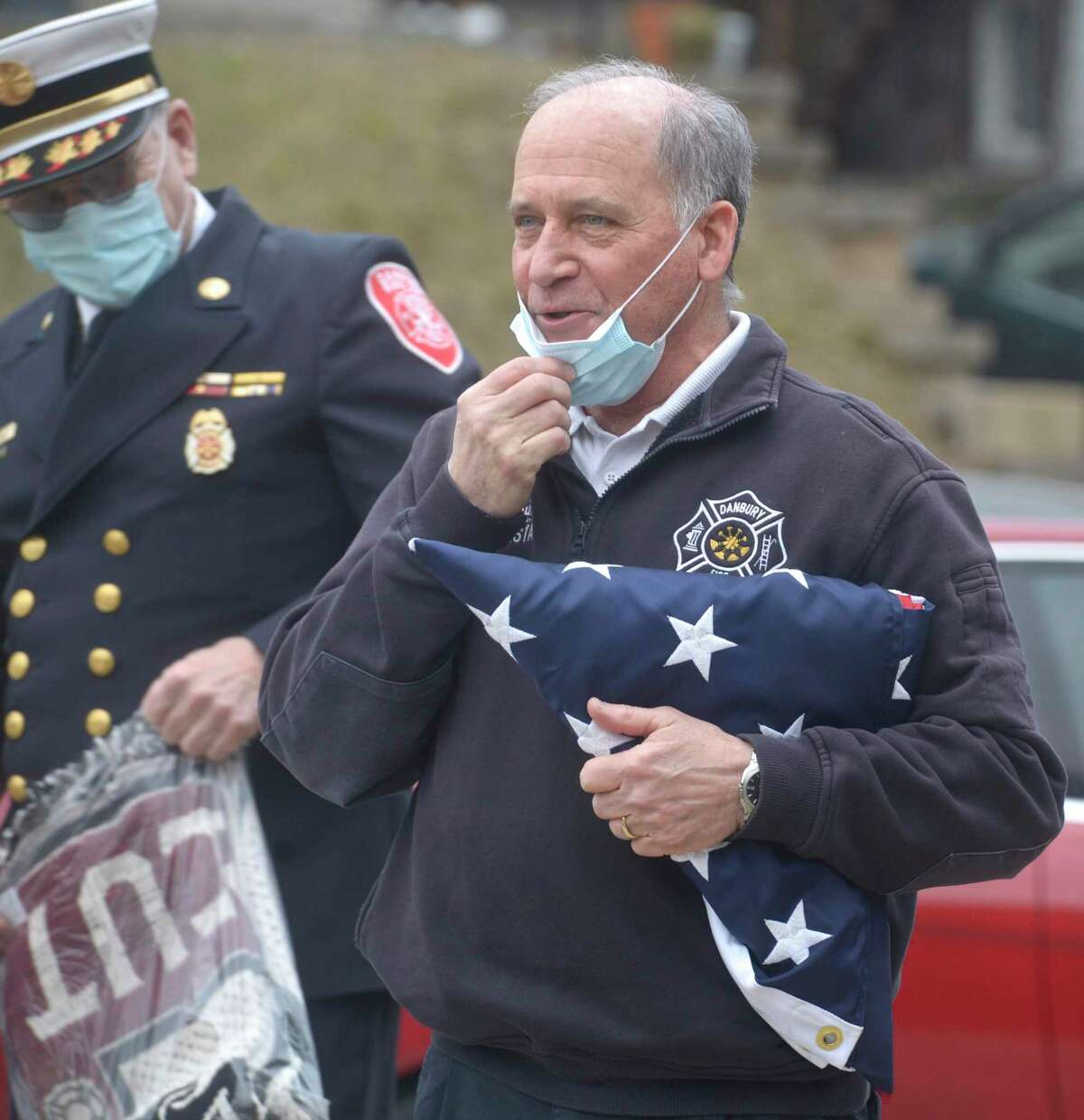 Danbury Fire Department Acting Fire Chief Mark Omasta speaks to the crowd that gather for his flag ceremony, a department tradition, on his last day on the job. Wednesday afternoon, January 14, 2021, in Danbury, Conn.