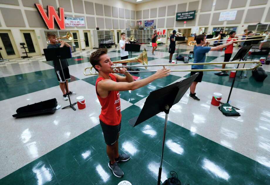 Gabriel Bustos practices with other trombone players before marching band practice at The Woodlands High School, Wednesday, June 17, 2020, in The Woodlands. The internal audit department for Conroe Independent School District found 153 instruments at an estimated replacement value of nearly $440,000 are missing during its audit last school year. Photo: Jason Fochtman, Houston Chronicle / Staff Photographer / 2020 © Houston Chronicle