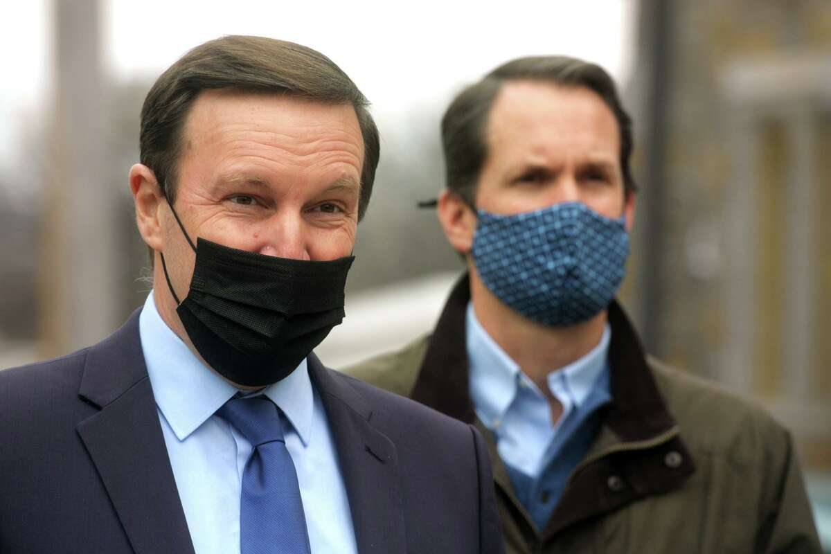US Sen. Chris Murphy speaks during a tour of the Thomas Merton Center, in Bridgeport, Conn. Jan. 11, 2021. Murphy is seen here with US Rep. Jim Himes.