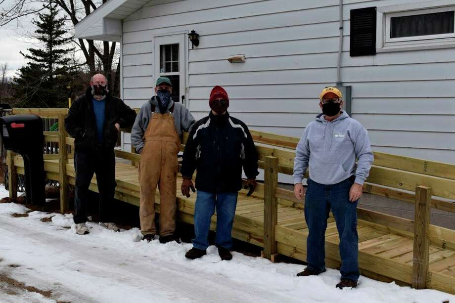 Habitat for Humanity Benzie Site Selection and Construction Committee members (from left to right) Don Bridges, Steve VanDePere, Bill Frostic and Glen Tracy, recently constructed a ramp for the widow of a WWII veteran. (Courtesy Photo)