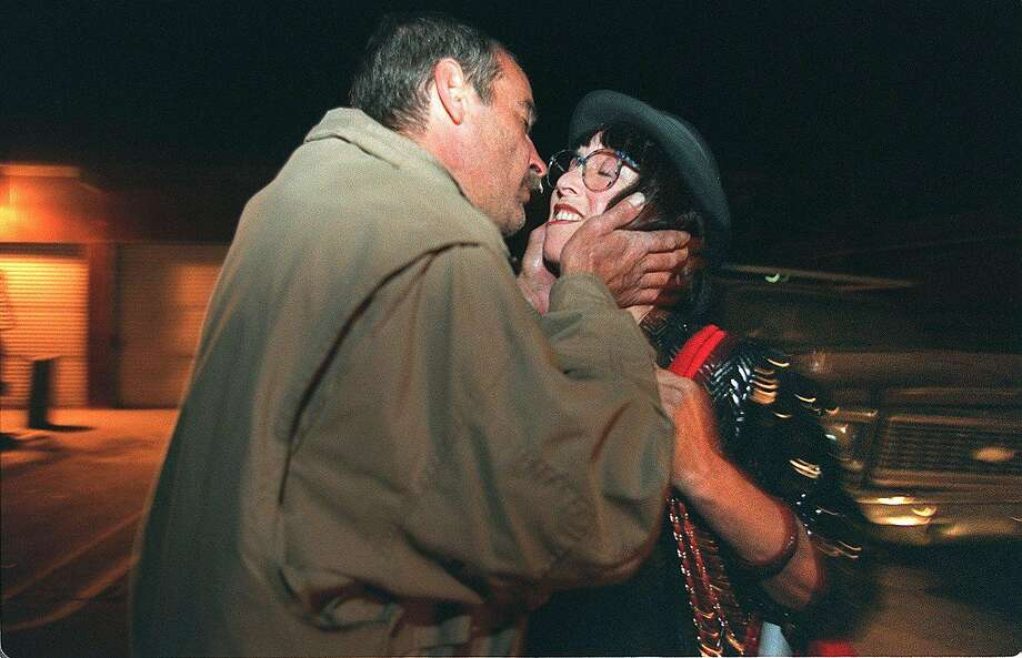Margo St. James, former prostitute, gets a kiss from Robert McNie, a friend, on the way to her party to find out if she is voted as S.F. Supervisor. Photo: Deanne Fitzmaurice / The Chronicle 1996