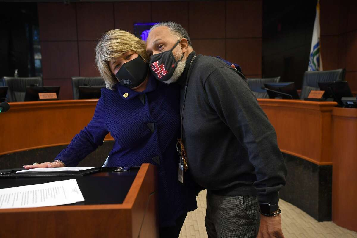 Mayor Becky Ames gets a hug from city attorney Tyronne Cooper after she announced Wednesday in council chambers that she would not be seeking re-election. Ames has served as Beaumont's Mayor since 2007. Photo taken Wednesday, January 13, 2021 Kim Brent/The Enterprise