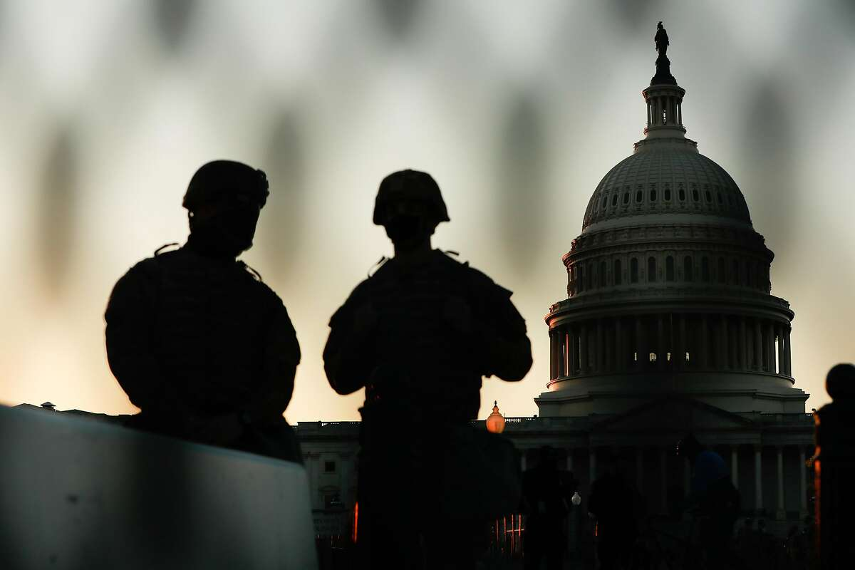 Members of the National Guard stand outside the U.S. Capitol on Tuesday in Washington, D.C.