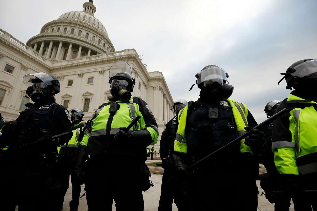Police during the Jan. 6 riot at the U.S. Capitol. An appeals court ruling in a separate case may be relevant after President Trump incited the insurrection.