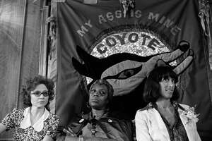 View of, from left, American feminists Ti-Grace Atkinson, Florynce 'Flo' Kennedy (1916 - 2000), and Margo St James as they pose beneath a 'Coyote' banner at a convention, Washington DC, 1976. St James had founded 'Coyote' (a backronym for 'Cast Off Your Old Tired Ethics') in 1973 as a sex workers' rights organization.