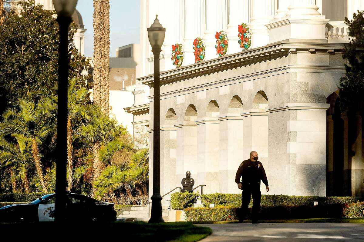California Highway Patrol officers stand watch outside the state Capitol in Sacramento following a protest in support of President Trump on Jan. 6.