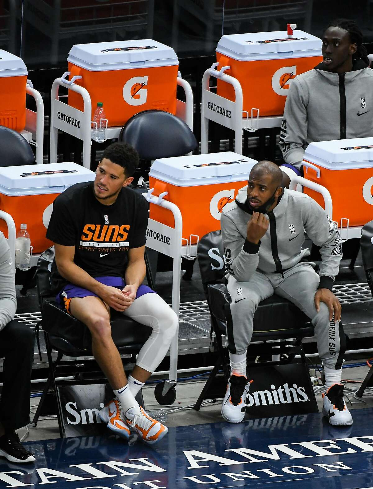Devin Booker and his new teammate Chris Paul have the Suns off to a 7-4 start, but they've now had two games postponed.