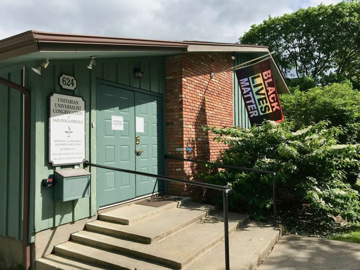 The Unitarian Universalists Congregation of Saratoga Springs proudly flies a Black Lives Matter banner and an LGBTQ rainbow pride flag to welcome diversity. Its worship services are often unique. The last Sunday of each year, congregants read poems to each other rather than listen to a sermon.