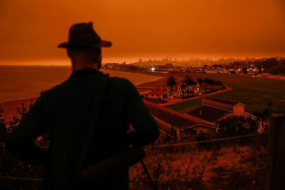 Hanno Botha looks out at the Presidio shrouded in dark orange smoke in San Francisco in September.