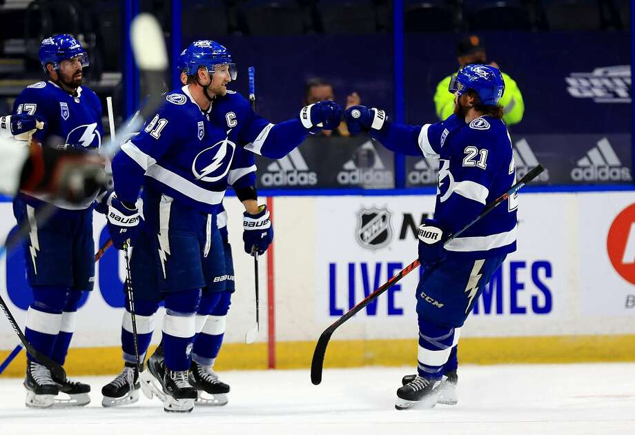 Tampa Bay's Steven Stamkos (91) celebrates one of his two goals against Chicago in the season opener for both teams. Photo: Mike Ehrmann / Getty Images