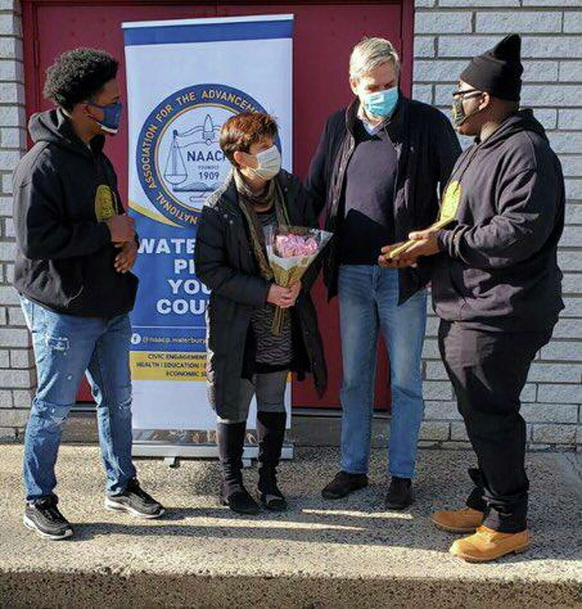 Amy and Bob Stefanowski, at center, received an award from the Waterbury NAACP Youth Corps on Sept. 9, 2021, for their volunteer work buying and distributing masks in the spring of 2020.