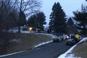 The sun rose Thursday morning to reveal State Police, investigators and evidence technicians hunting for clues and information about a shooting Wednesday at a home on Angelo Drive in Schodack.