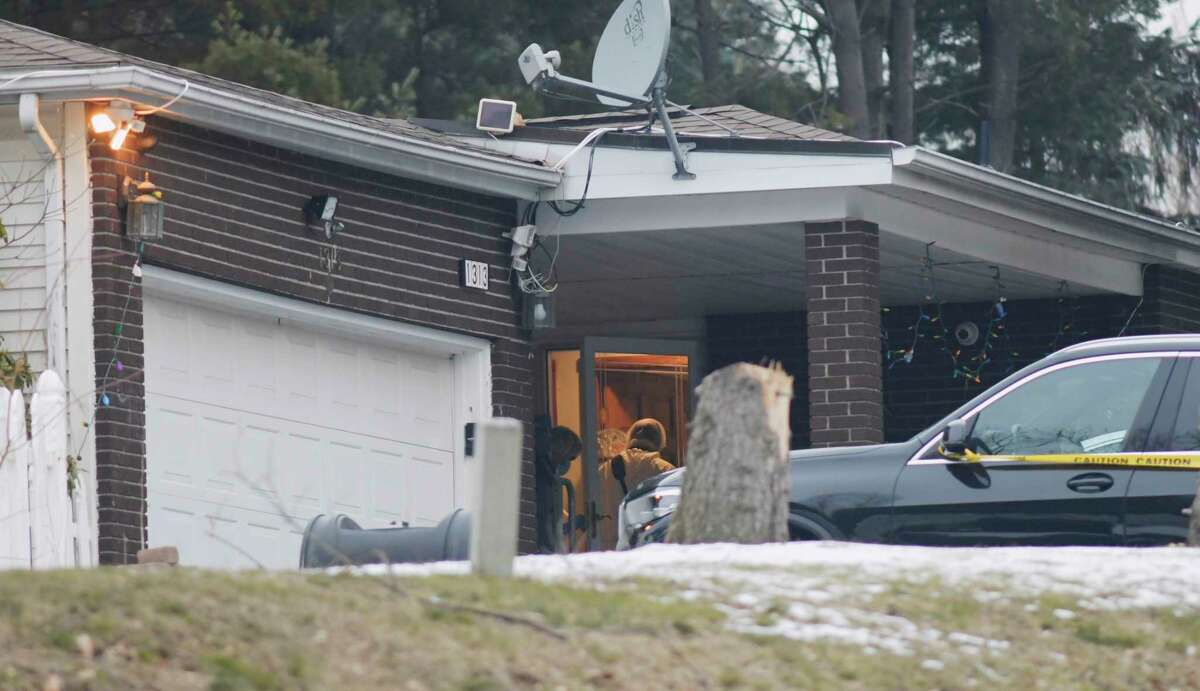 Police are investigating killings that took place at a home located at 1313 Angelo Drive on Thursday, Jan. 14, 2021, in Schodack, N.Y. State Police said an assailant killed two people before committing suicide. Another victim was being treated for a non-life-threatening gunshot wound, troopers said.(Paul Buckowski/Times Union)