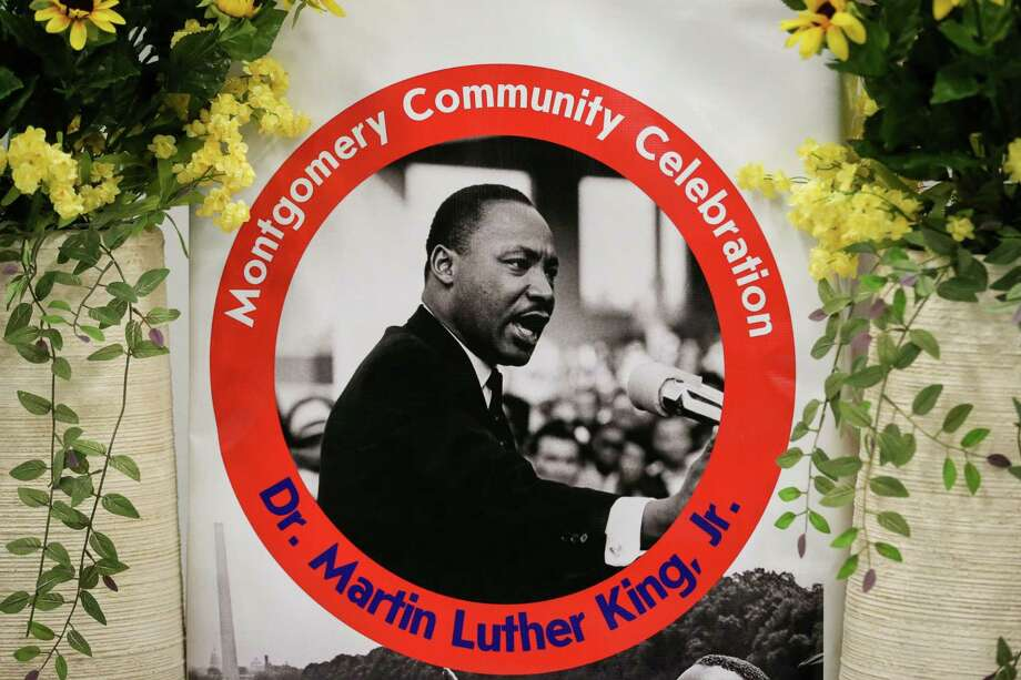Dr. Martin Luther King, Jr. is pictured on a podium before the start of a previous celebration in his memory on Monday, Jan. 15, 2018, at the Lone Star Community Center in Montgomery. The event will not take place this year because of COVID-19. Photo: Michael Minasi, Staff Photographer / Houston Chronicle / © 2017 Houston Chronicle