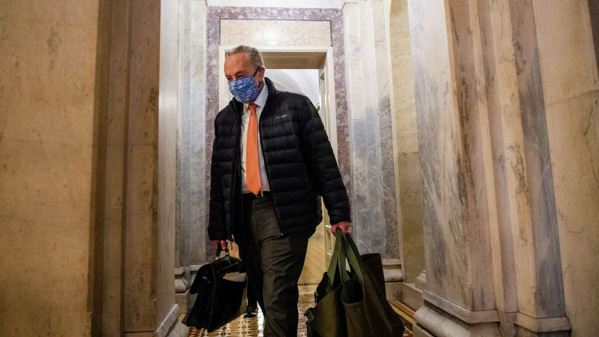 Senate Minority Leader Chuck Schumer, D-N.Y., who will become majority leader now that Democrats have won control of the Senate, leaves the Capitol after a vote on Jan. 1.