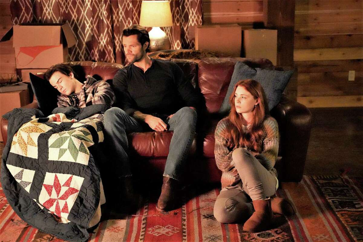 Walker (Jared Padalecki), center, shares a quiet moment with his son and daughter, August (Kale Culley) and Violet Brinson as Stella Walker.