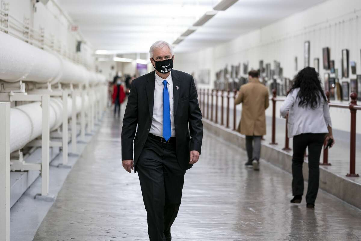 Rep. Tom McClintock, R-Calif., wears a protective mask while walking through the Canon Tunnel to the U.S. Capitol on Jan. 12, 2021, in Washington, D.C.